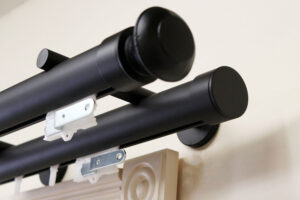 "1-5/8"" double ONAGLIDE™ in Black with Kingston finial"